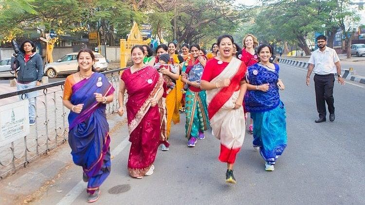 Dressed in sarees, you'd never think that these women were actually there to run a marathon.