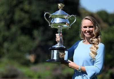 MELBOURNE, Jan. 28, 2018 (Xinhua) -- Caroline Wozniacki of Denmark poses with her Australian Open trophy, the Daphne Akhurst Memorial Cup in the Royal Botanical Gardens in Melbourne, Australia, Jan. 28, 2018. (Xinhua/Bai Xuefei/IANS)