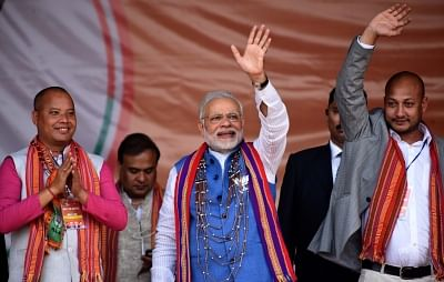 Phulbari: Prime Minister Narendra Modi waves at supporters during an election rally in Meghalaya