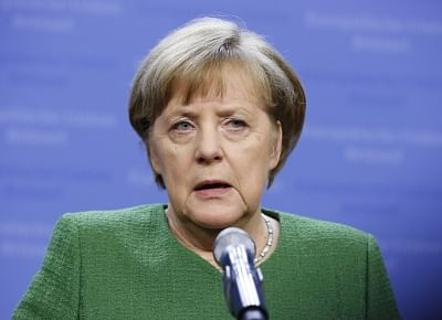 BRUSSELS, Feb. 23, 2018 (Xinhua) -- German Chancellor Angela Merkel addresses a press conference after a summit of the 27 EU leaders excluding British prime minister in Brussels, Belgium, on Feb. 23, 2018. Most European leaders were on the same page at an informal summit to claw back their says in picking the successor to Jean-Claude Juncker, incumbent president of the European Commission. (Xinhua/Ye Pingfan/IANS)