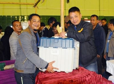 Shillong: Polling officials collect the Electronic Voting Machines (EVMs) and other necessary materials to be used in Meghalaya Assembly Election, in Shillong on Feb 25, 2018. (Photo: IANS/PIB)
