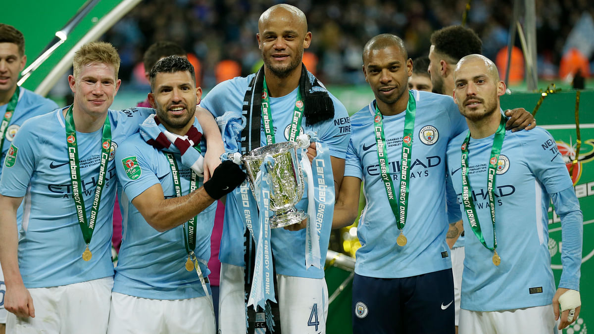 Manchester City players celebrate after winning the English League Cup Final against Arsenal 3-0 at Wembley stadium in London on Sunday.