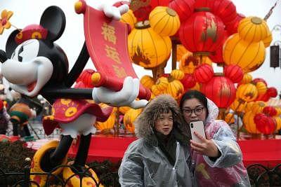 SHANGHAI, Feb. 16, 2018 (Xinhua) -- People take photo at Disney Resort in east China