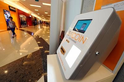 SINGAPORE, March 6, 2014 (Xinhua) -- A Bitcoin dispensing machine is seen at an underground shopping mall in Singapore, March 6, 2014. Singapore police have confirmed that Autumn Radtke, the American CEO of Singapore bitcoin exchange First Meta, was found dead in her home late last month. (Xinhua/Then Chih Wey/IANS)