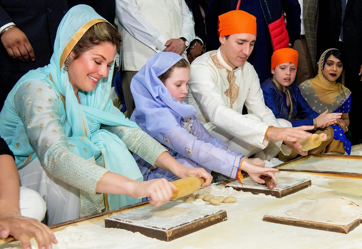 Canadian Prime Minister Justin Trudeau along with his family members prepare langar.