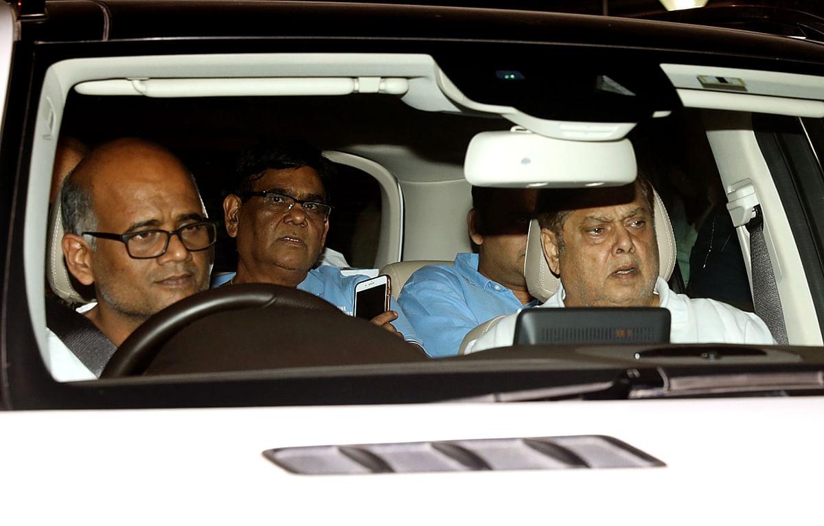 Satish Kaushik and David Dhawan drive in.