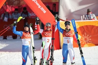 PYEONGCHANG, Feb. 13, 2018 (Xinhua) -- Gold medalist Marcel Hirscher of Austria (C), silver medalist Alexis Pinturault of France, and bronze medalist Victor Muffat-Jeandet of France pose for group photos after the men