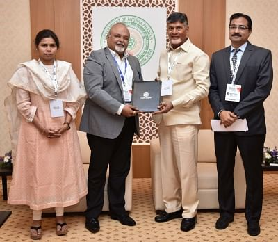 Vizag: Andhra Pradesh Chief Minister N. Chandrababu Naidu and Club Mahindra Head Development Monesh Vig during a meeting at Partnership Summit 2018 in Vizag on Feb 24, 2018. (Photo: IANS)