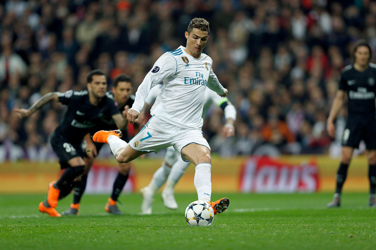 Real Madrid's Cristiano Ronaldo scores his side's first goal from the penalty spot during their  Champions League Round of 16 first leg match against Paris Saint Germain at the Santiago Bernabeu stadium in Madrid