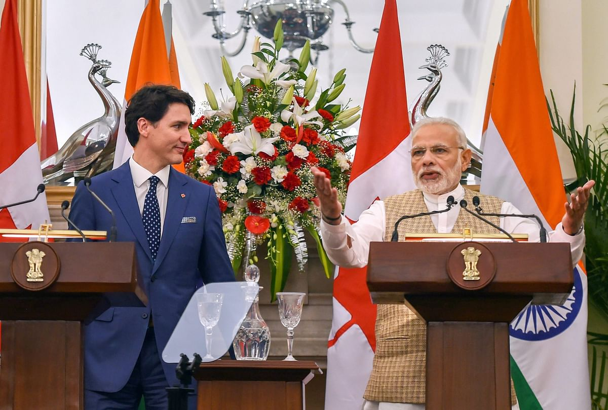 PM Modi speaks as his Canadian counterpart Justin Trudeau looks on, during their joint press conference