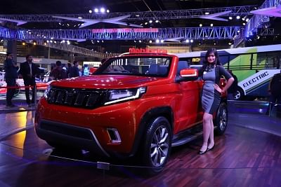 Greater Noida: A model showcases a Mahindra SUV at the Auto Expo 2018 in Greater Noida on Feb 11, 2018. (Photo: IANS)