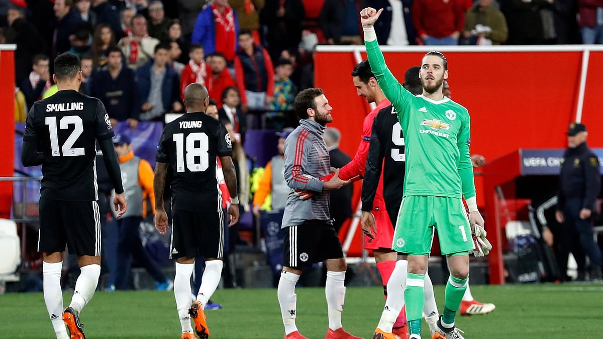 Manchester United goalkeeper David de Gea (right) gestures to the supporters at the end of the Champions League round of sixteen  match against Sevilla FC.