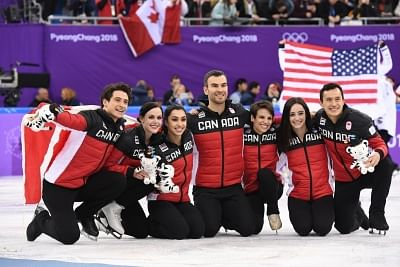 PYEONGCHANG, Feb. 12, 2018 (Xinhua) -- Team Canada celebrate after winning the figure skating team event at the 2018 PyeongChang Winter Olympic Games, in Gangneung Ice Arena, South Korea, on Feb. 12, 2018. Canada won the gold medal with 73 points in total. (Xinhua/Wang Song/IANS)