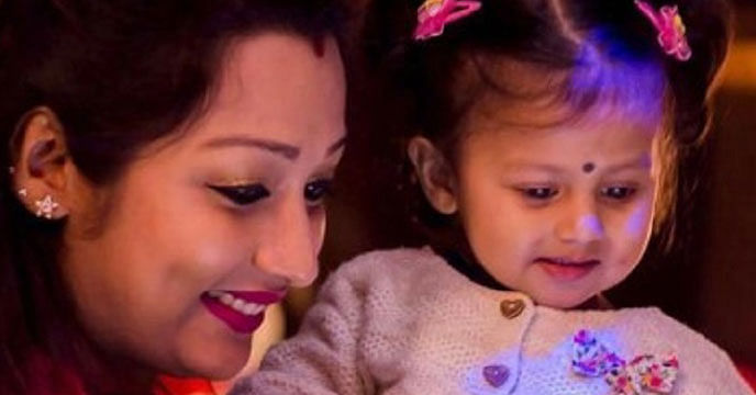 Shampa Paul Dey with Oyetri on her first birthday.