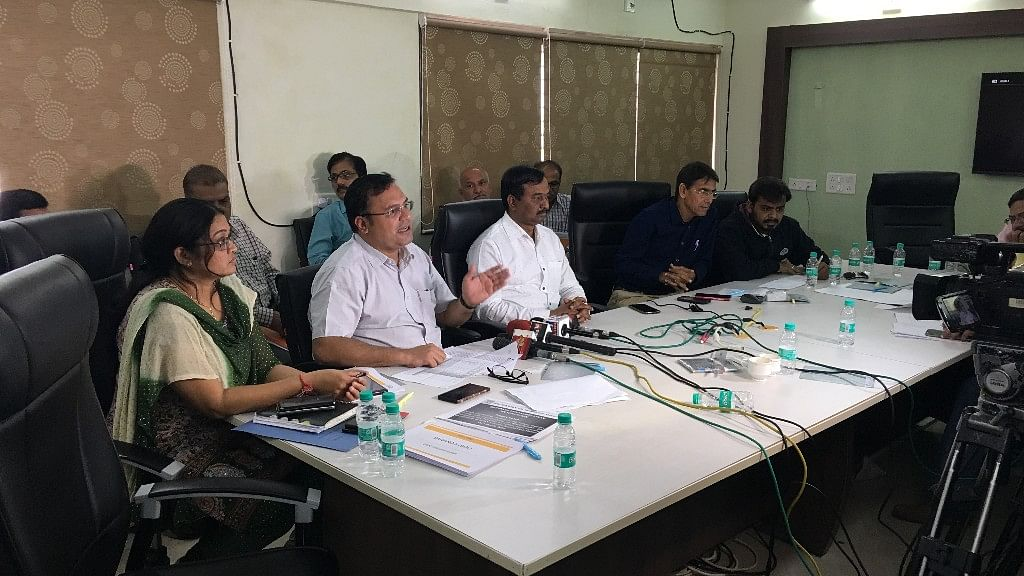 (Centre) Chintan Akhani, Divisional Manager, Ahmedabad, GIDC addresses the media on Friday, 9 February at Sanand GIDC office