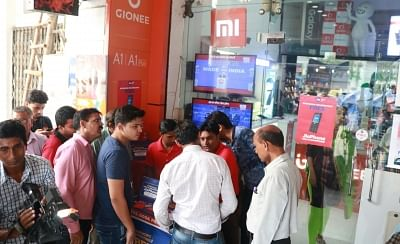 New Delhi: People wait in queues during the first day of JioPhone pre-booking in New Delhi on Aug 24, 2017. (Photo: IANS)