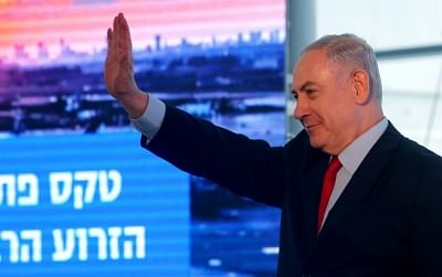 TEL AVIV, Feb. 15, 2018 (Xinhua) -- Israeli Prime Minister Benjamin Netanyahu waves at a dedication ceremony of the new concourse at the Ben Gurion Airport outside Tel Aviv, Israel, on Feb. 15, 2018. Israeli Prime Minister Benjamin Netanyahu lashed out at the police on Wednesday, a day after the police said there was sufficient evidence to indict him on charges of corruption and while the opposition called him to resign. (Xinhua/Gil Cohen Magen/IANS)
