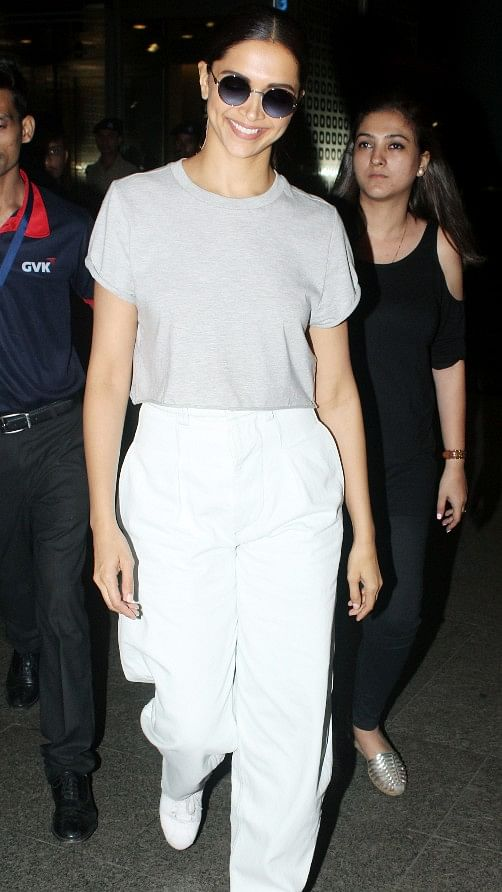 Deepika Padukone is all smiles at the airport.