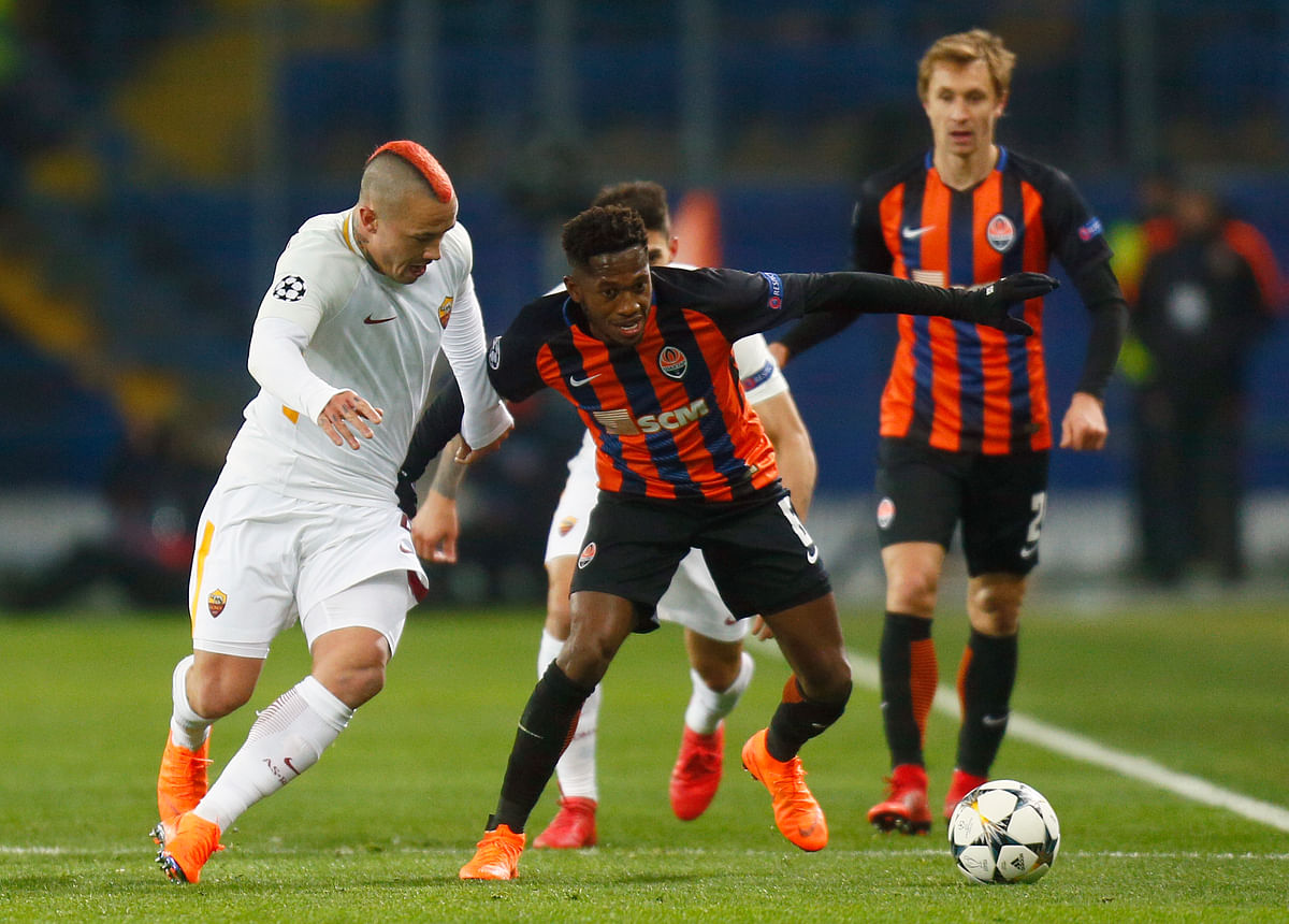 Roma's Radja Nainggolan (left) duels for the ball with Shakhtar's Fred (centre), during the Champions League, round of 16 match between in Kharkiv, Ukraine