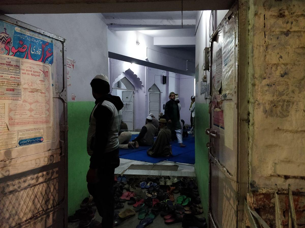 Muslims emerging from a mosque after evening prayers.