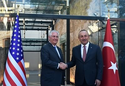 ISTANBUL, July 10, 2017 (Xinhua) -- Turkish Foreign Minister Mevlut Cavusoglu (R) shakes hands with visiting U.S. Secretary of State Rex Tillerson in Istanbul, Turkey, July 9, 2017. Mevlut Cavusoglu and Turkish President Recep Tayyip Erdogan had separate meetings on Sunday in Istanbul with Rex Tillerson, as the two NATO allies are sharply divided over Syria. (Xinhua/Zeynep Cermen/IANS)