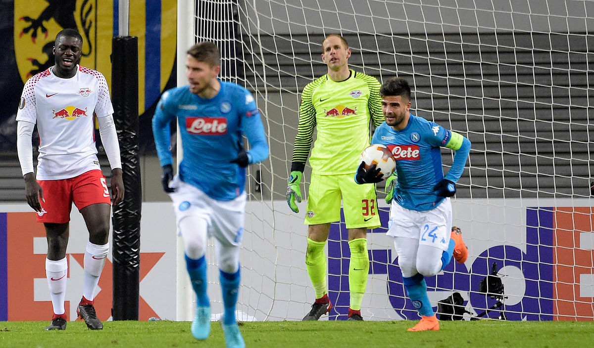 Napoli's Lorenzo Insigne takes the ball after scoring his side's second goal.