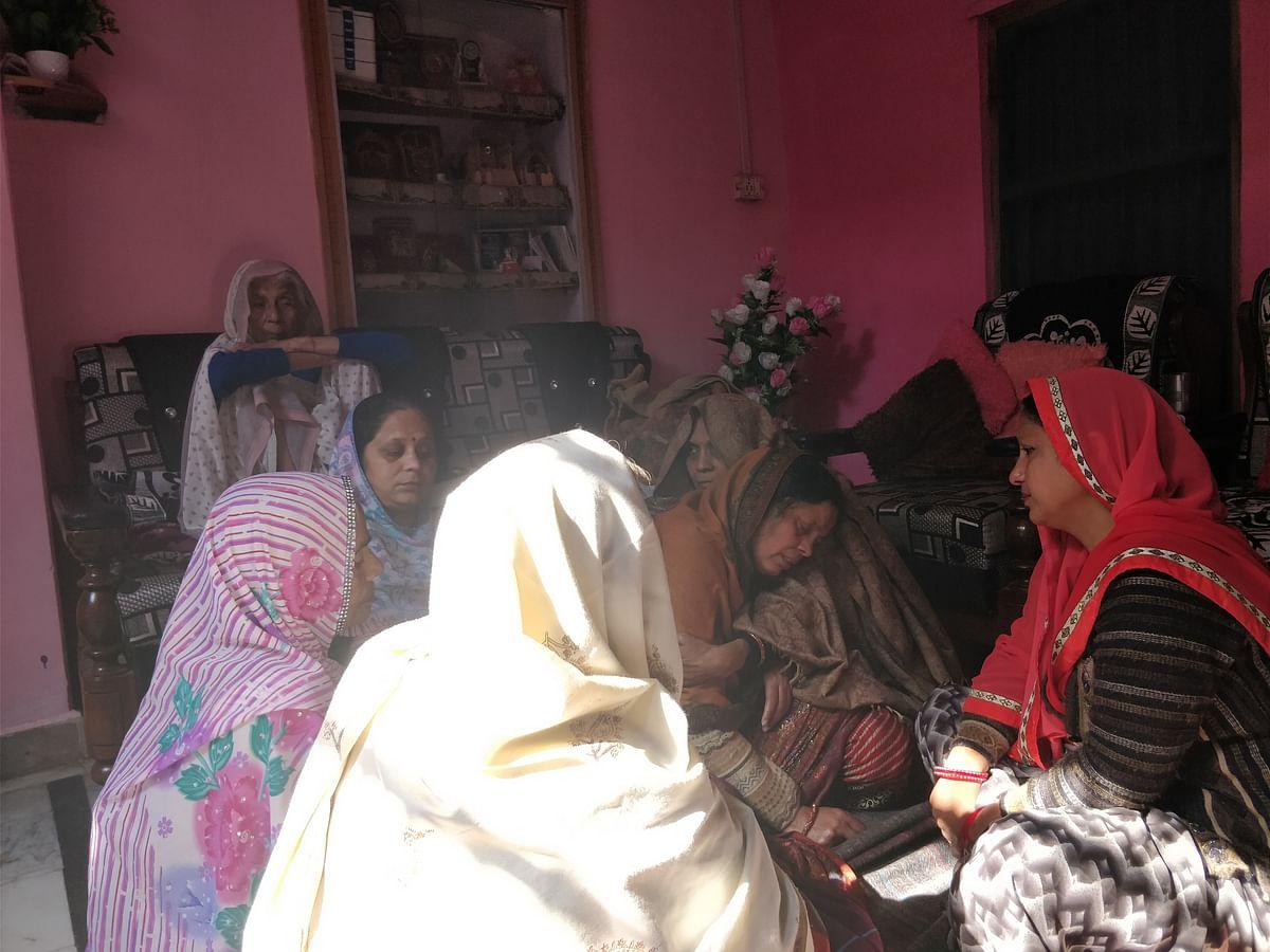 The grieving womenfolk of Chandan Gupta's family.