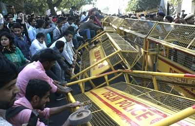 New Delhi: JNU students try to break police barricade as they stage a demonstration outside CBI headquarters in New Delhion Feb 26, 2018. (Photo: IANS)
