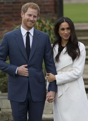 LONDON, Nov. 27, 2017 (Xinhua) -- Prince Harry (L) and Meghan Markle attend an official photocall to announce their engagement in London, Britain, on Nov. 27, 2017. British royal family confirmed Monday that Prince Harry has already been engaged with his girlfriend Meghan Markle earlier this month in London. (Xinhua/IANS)