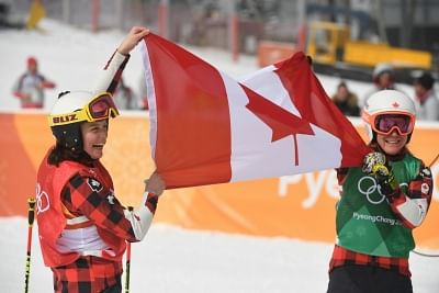 PYEONGCHANG, Feb. 23, 2018 (Xinhua) -- Gold medalist Kelsey Serwa of Canada (L) and silver medalist Brittany Phelan of Canada celebrate after winning the ladies