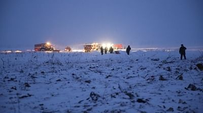 MOSCOW, Feb. 11, 2018 (Xinhua) -- Russian Emergencies Ministry employees work near the site of an air crash outside Moscow, Russia, on Feb. 11, 2018. A passenger plane with 71 on board crashed shortly after leaving Moscow, with no hope of survival of the crew and passengers, a source in emergency services told the Interfax news agency on Sunday. (Xinhua/Sputnik/IANS)
