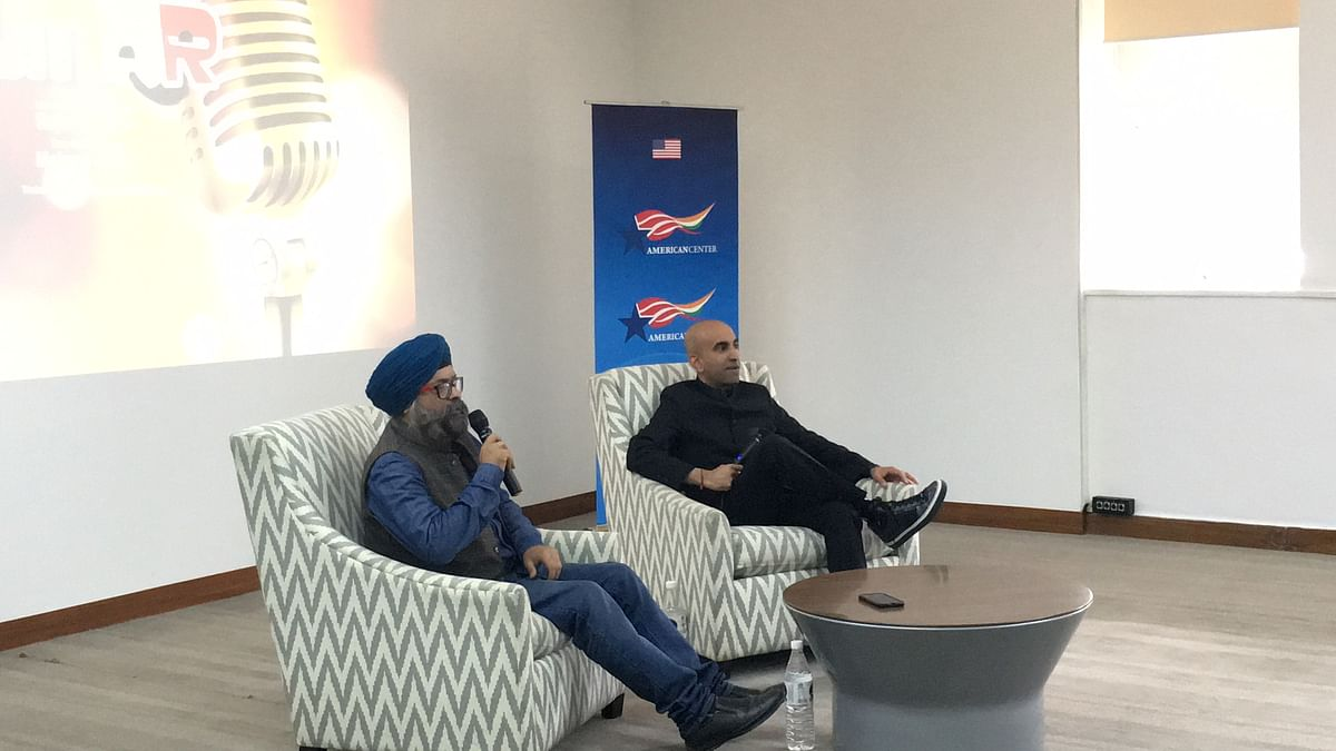(from left) Maheep Singh and Rajiv Satyal, share the stage at American Center.