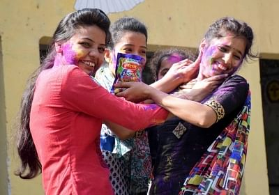 If you are hosting a Holi party at home, first make your walls stain-proof and then decorate the open area with flowers and colourful dupattas, suggest experts. (Photo: IANS)