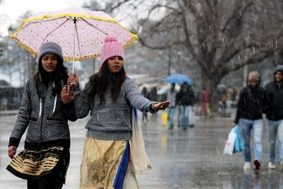 Shimla: Tourists enjoy themselves after snowfall in Shimla on Feb 13, 2018. (Photo: IANS)