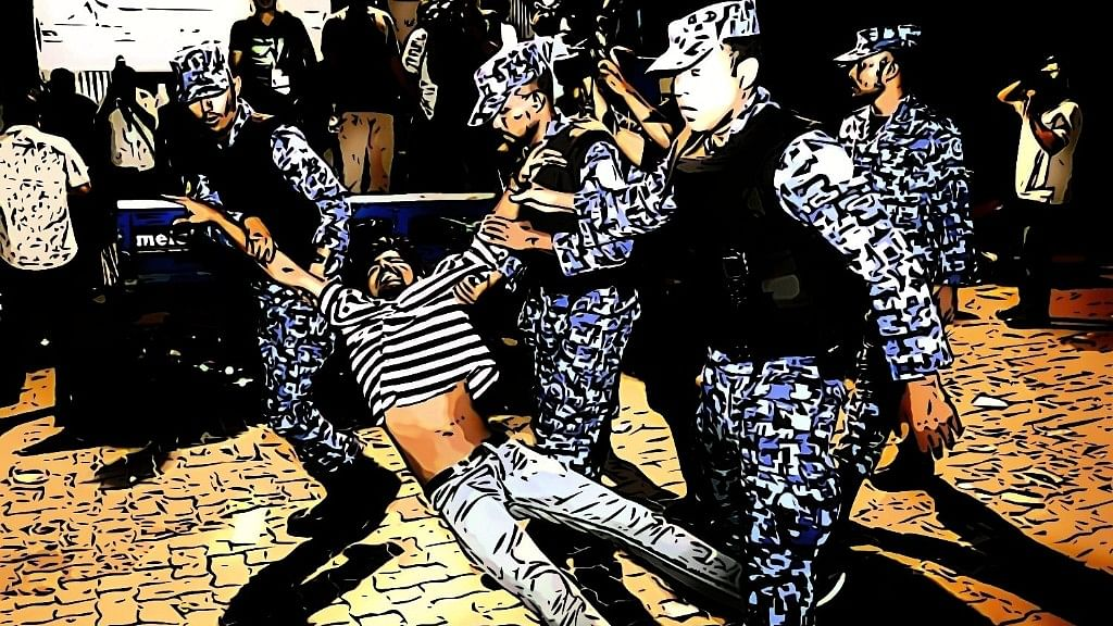 A protester is dragged away by members of the Maldivian Defence Force.