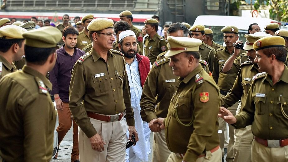 Aam Aadmi Party (AAP) MLAs Amanatullah Khan and  Prakash Jarwal being produced at Tis Hazari court in New Delhi, on Thursday.