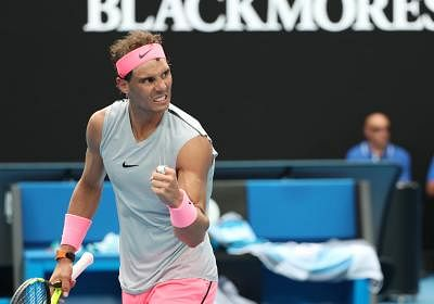 MELBOURNE, Jan. 21, 2018 (Xinhua) -- Rafael Nadal of spain celebrates after the men