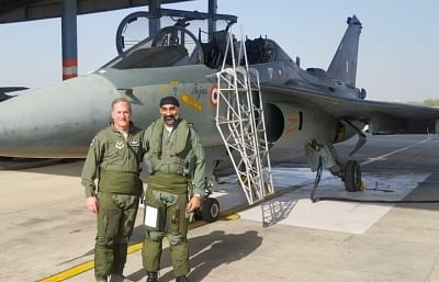 Jodhpur: Chief of US Air Force, General David L. Goldfein with Air Vice Marshal A.P. Singh at the IAF station in Jodhpur on Feb 3, 2018. The Chief of US Air Force, General David L. Goldfein, flew a sortie in the indigenous Light Combat Aircraft Tejas on Saturday. The indigenous LCA is a single-seat, single-jet engine, multirole light fighter. Goldfein arrived in India on Thursday, on a visit to boost defence ties between the two nations. (Photo: IANS/DPRO)