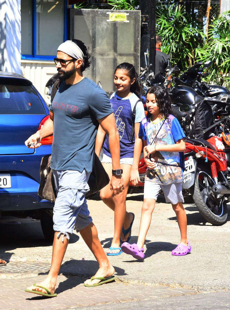 Farhan with his daughters.