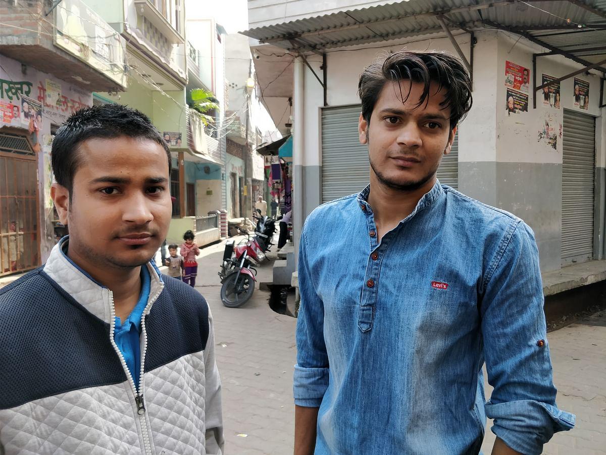 Farman Akhtar, a graduate in Mathematics, and Azhar Ghani (right), both college graduates who work as SIM operators in a Kasganj Jio store.