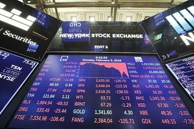 An electronic screen displaying trading data is seen at the New York Stock Exchange in New York (File Photo: Xinhua/Wang Ying/IANS)