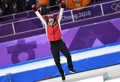 PYEONGCHANG, Feb. 15, 2018 (Xinhua) -- Ted-Jan Bloemen of Canada celebrates during venue ceremony of men