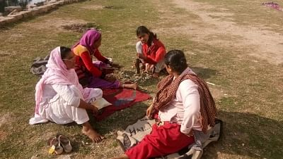 Women working and relaxing in their newly-found park.