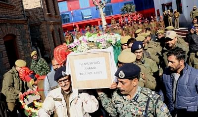 Srinagar: The body of police constable Mushtaq Ahmad being brought ahead of a wreath laying ceremony in Srinagar on Feb 6, 2018. In an attack, militants helped a Pakistani LeT terrorist escape by firing at the police party escorting him to hospital on Tuesday, leaving police constable Mushtaq Ahmad dead and another wounded. (Photo: IANS)