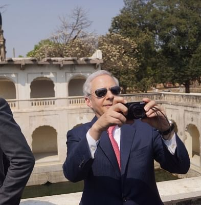 Hyderabad: US Ambassador to India Kenneth I. Juster clicks pictures with his camera during his visit to the Qutub Shahi Tombs in Hyderabad on Feb 28, 2018. (Photo: IANS)