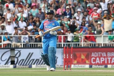 Johannesburg: MS Dhoni of India departs after being bowled by Chris Morris of South Africa during the 1st T20 International match between South Africa and India at the Wanderers Stadium in Johannesburg, South Africa on Feb 18, 2018. (Photo: BCCI/IANS) (Credit Mandatory)