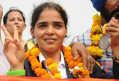 Khushbir Kaur who won silver medal in 20km Race Walk category at Incheon Asian Games 2014 being welcomed on her arrival at Amritsar Railway Station on Oct. 6, 2014. (Photo: IANS)