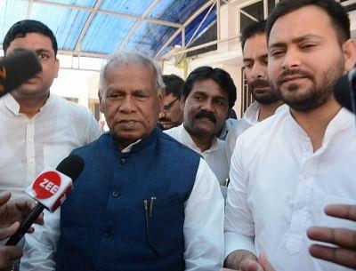 Patna: Hindustani Awam Morcha-Secular (HAM-S) Jitan Ram Manjhi along with RJD leaders Tejashwi Yadav and Tej Pratap Yadav in Patna on Feb 28, 2018. The Hindustani Awam Morcha-Secular (HAM-S) on Wednesday announced its exit from the National Democratic Alliance (NDA) with the BJP and said it would be joining the Grand Alliance led by the Rashtriya Janata Dal. (Photo: IANS)
