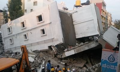 Bengaluru: Rescue operations underway at the site where a four-storeyed under-construction building collapsed killing three construction workers in Bengaluru, on Feb 15, 2018. (Photo: IANS)