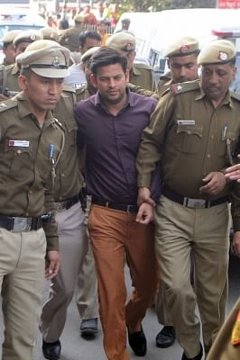 Aam Aadmi Party MLA Prakash Jarwal being taken to be produced at Tees Hazari Court in connection with alleged attack on Delhi Chief Secretary Anshu Prakash, in New Delhi on Feb 21, 2018. (Photo: IANS)